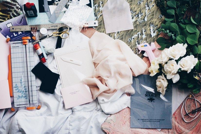 a jumble of fabrics, flowers, haberdashery and stationary